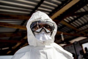 Dr. Peter Githua is seen in personal protective equipment (PPE) before heading to the red zone of an Ebola treatment unit (ETU) in Sinje, Grand Cape Mount, Liberia.  The facility is operated by the International Organization for Migration (IOM) in partnership with Liberia's Ministry of Health and Social Welfare (MOHSW) and supported by USAID's Office of U.S Foreign Disaster Assistance. It opened with a capacity of 10 beds, but can rapidly scale to provide care to up to 50 people.  The ETU is staffed with 23 medical professionals from Kenya, South Africa, Tanzania, Uganda and Ukraine, as well as 114 Liberians from Grand Cape Mount county, who were recruited and trained to offer clinical and non-clinical care within the facility.  The staff received training from the World Health Organisation (WHO) and the MOHSW, and experienced hands-on training at the IOM-managed ETU in Tubmanburg, Bomi County, Liberia.  Sinje, Grand Cape Mount, Liberia, on 27 January 2015 Photo: UNMEER/Martine Perret